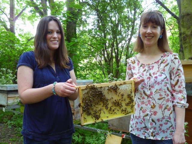 Emma and me holding a frame of bees