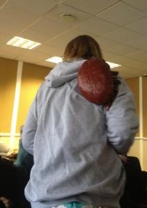 Karin Alton wearing a human sized varroa mite