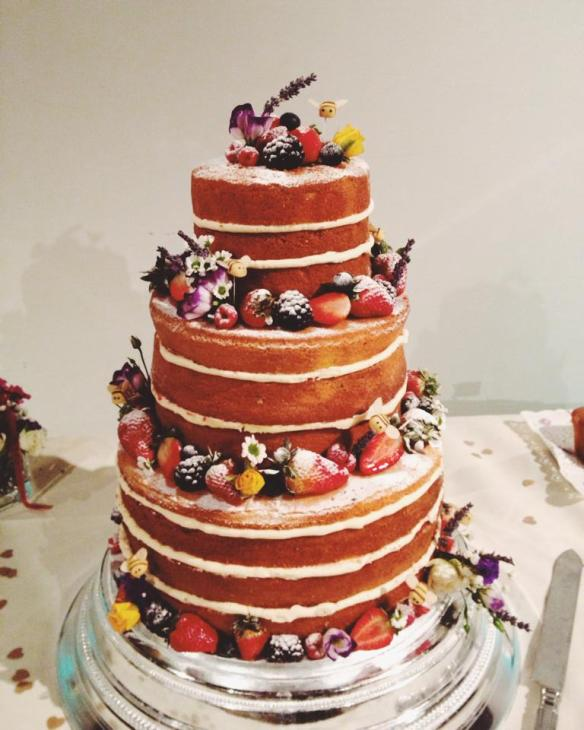 Our sponge, jam and cream wedding cake, decorated with fruit, flowers and marzipan bees. Made by Michelle at Maya Cakes - http://mayacakes.co.uk