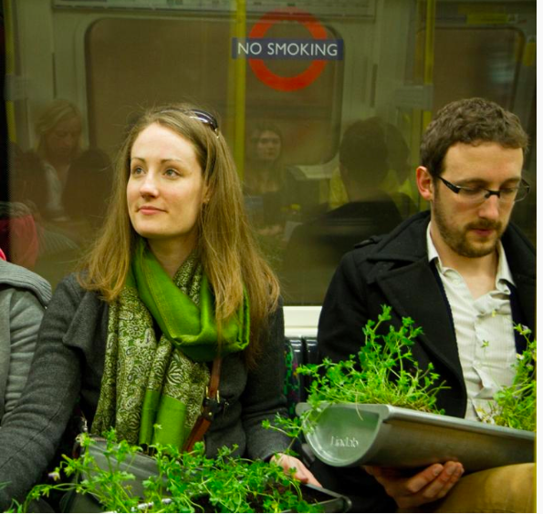 Image of gardeners on London tube from www.riverofflowers.org